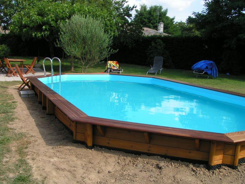 Installation piscine bois cerland moor a solt ra 4 90 x 8 40 for Installation piscine bois